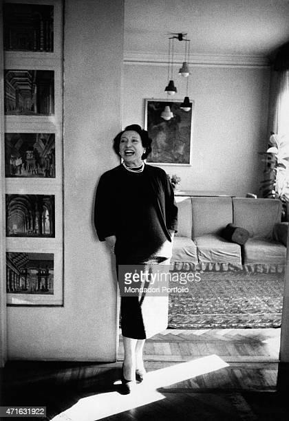 'Italian soprano Mafalda Favero smiling leaning against a wall Milan April 1953 '