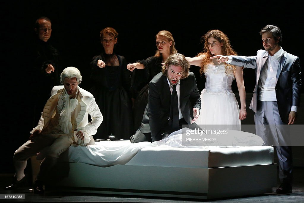 Italian Soprano Serena Malfi (2ndR), Canadian Robert Gleadow (C), Argentinian Nahuel Di Pierro (R), Austrian barytone Markus Werba (L) and Swedish soprano Miah Persson perform during the 'generale' of the Mozart's 'Don Giovanni' Opera directed by Stephane Braunschweig with musical director Jeremie Rhorer at the Theatre des Champs-Elysees in Paris on April 23, 2013.