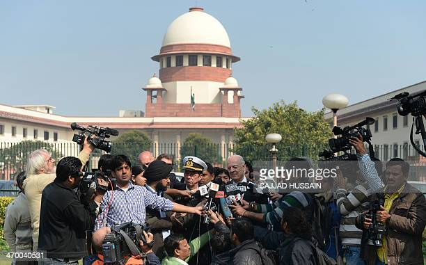 Italian Special Envoy Staffan de Mistura and military attache Franco Faure speak to media after a court hearing at the Supreme Court in New Delhi on...