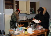 Italian special force police force inspect the house of Pasquale Condello following his arrest late February 18 2008 in Italy's soutern city of...