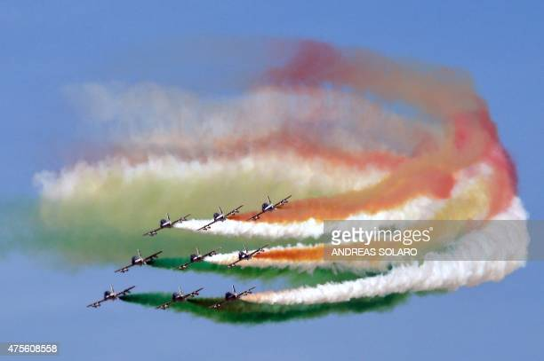 Italian special unit airforce 'Frecce Tricolori' spread smoke with the colours of the Italian flag over the military parade at Via dei Fori Imperiali...