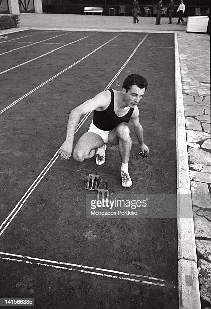 Italian sprinter Livio Berruti training and placing the starting blocks at the Rome Olympic Games Rome 1960