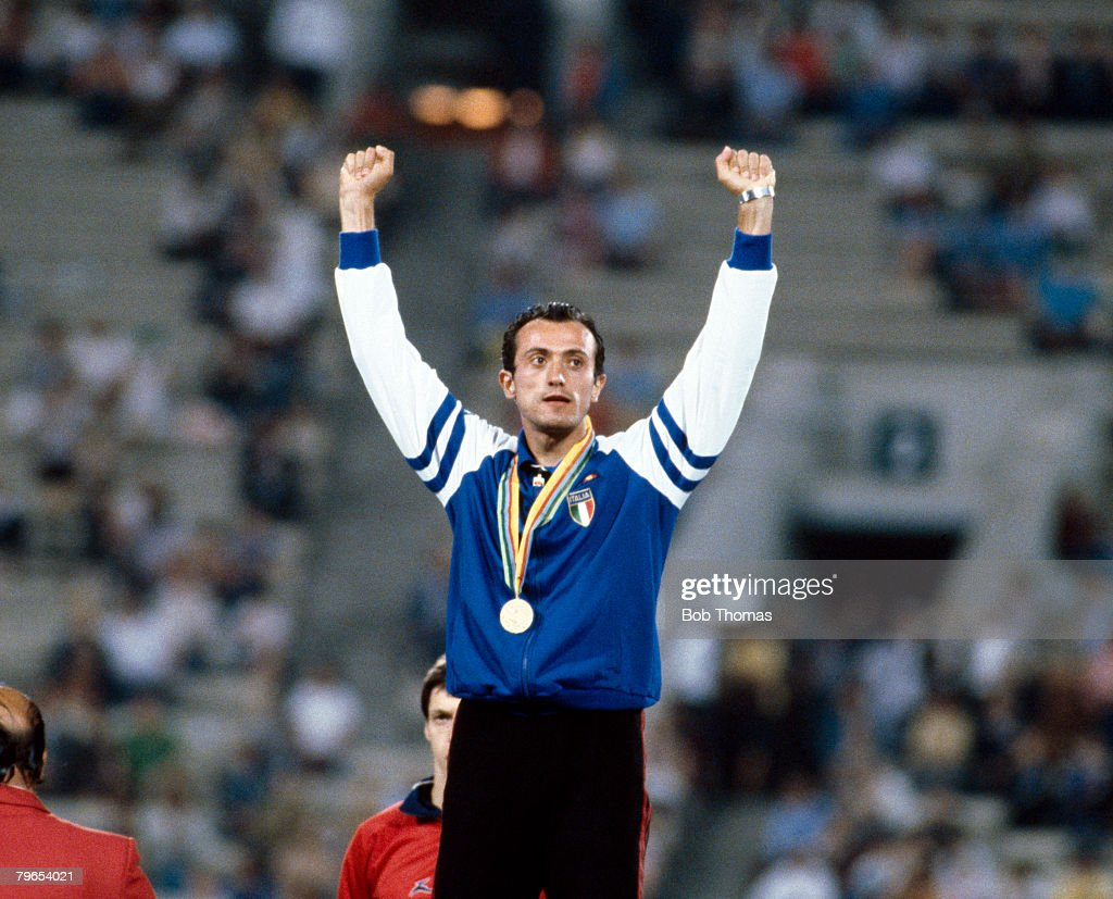 Italian sprinter Pietro Mennea stands in celebration with his hands in the air on the podium after winning the gold medal in the Men's 200 metres event at the 1980 Summer Olympics inside the Olympic stadium in Moscow, Soviet Union on 28th July 1980.