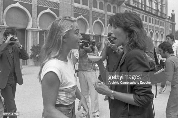 Italian stage actress Mariangela Melato with Eleonora Giorgi outside the Excelsior Hotel Lido Venice 1982