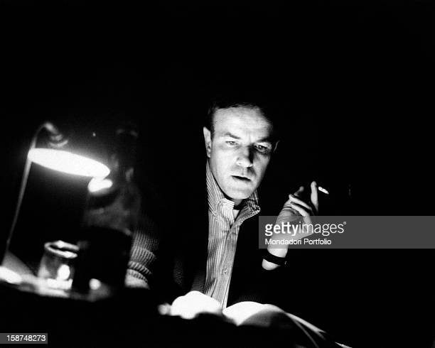 Italian stage director Franco Zeffirelli studies some personal notes seated at his desk within the Eliseo Theatre The roman theatre is hosting a...
