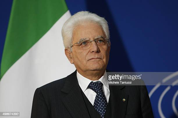 Italian state President Sergio Mattarella listens to the national anthem outside the plenary room of the European Parliament after the debate on the...