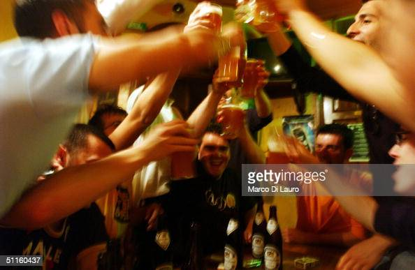 Italian students from the Primo Levi Technical Institute of Vignola in the Modena Province toast with glasses of beer in a pub during a school trip...