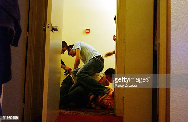 Italian students from the Primo Levi Technical Institute of Vignola in the Modena Province play around in the corridor of their hotel during a school...