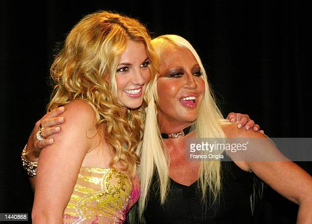 Italian stylist Donatella Versace and american singer Britney Spears acknowledges the applause for Versace's Spring/Summer women's 2003 collection...