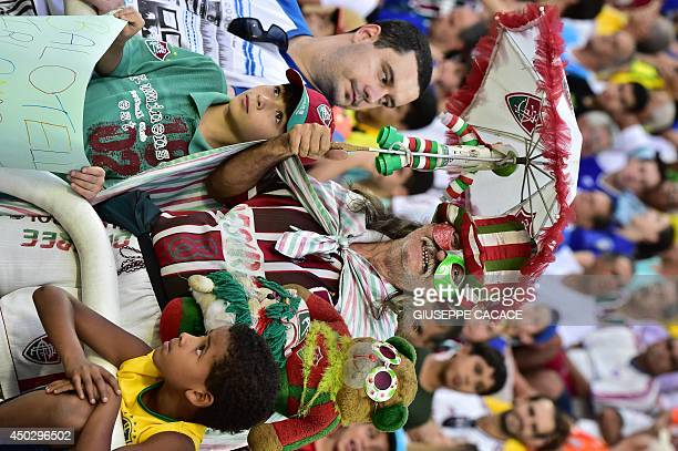 Italian supporters attend a friendly football match between Fluminense and Italy at the Raulino de Oliveira Stadium in Volta Redonda on June 8 2014...