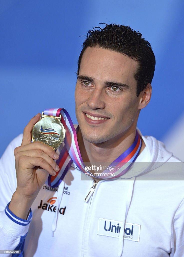 Italian swimmer Fabio Scozzoli holds his gold medal after he won the men's short course 50m breaststroke final at the European Swimming Championships on November 24, 2012, in Chartres.