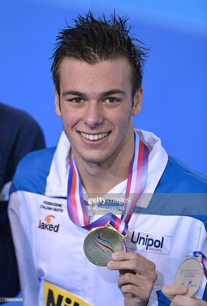 Italian swimmer Gregorio Paltrinieri holds his gold medal after he won the short course men's 1500m freestyle final at the European Swimming Championships on November 24, 2012, in Chartres.