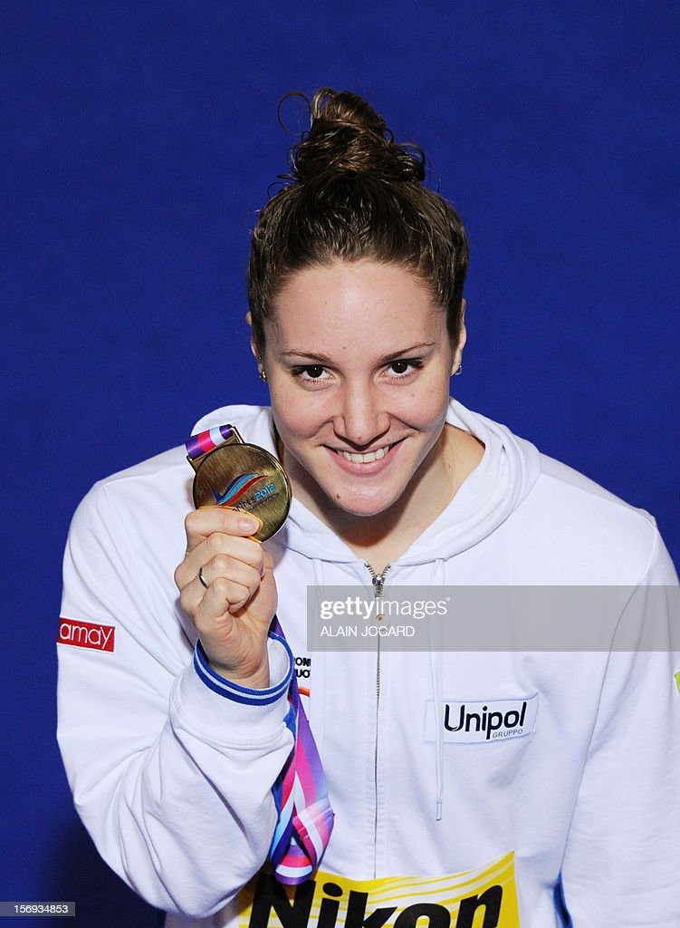 Italian swimmer Ilaria Bianchi poses after winning the women's short course 100 m butterfly final at the European Swimming Championships on November 25, 2012, in Chartres.