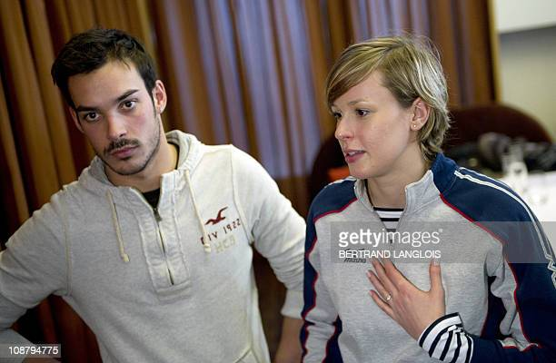 Italian swimmers Federica Pellegrini and Luca Marin leave after a press conference following their first training session at the Lagardere training...