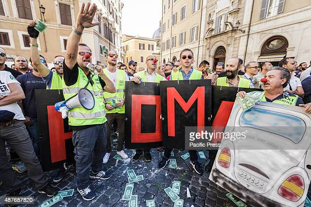 Italian taxi drivers shout slogans during a demonstration to protest against Uber service in Rome Hundreds of Italian taxi drivers took to the street...