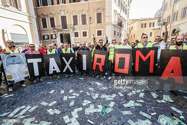 Italian taxi drivers shout slogans wave placards and hold banners during a demonstration to protest against Uber service in Rome Hundreds of Italian...