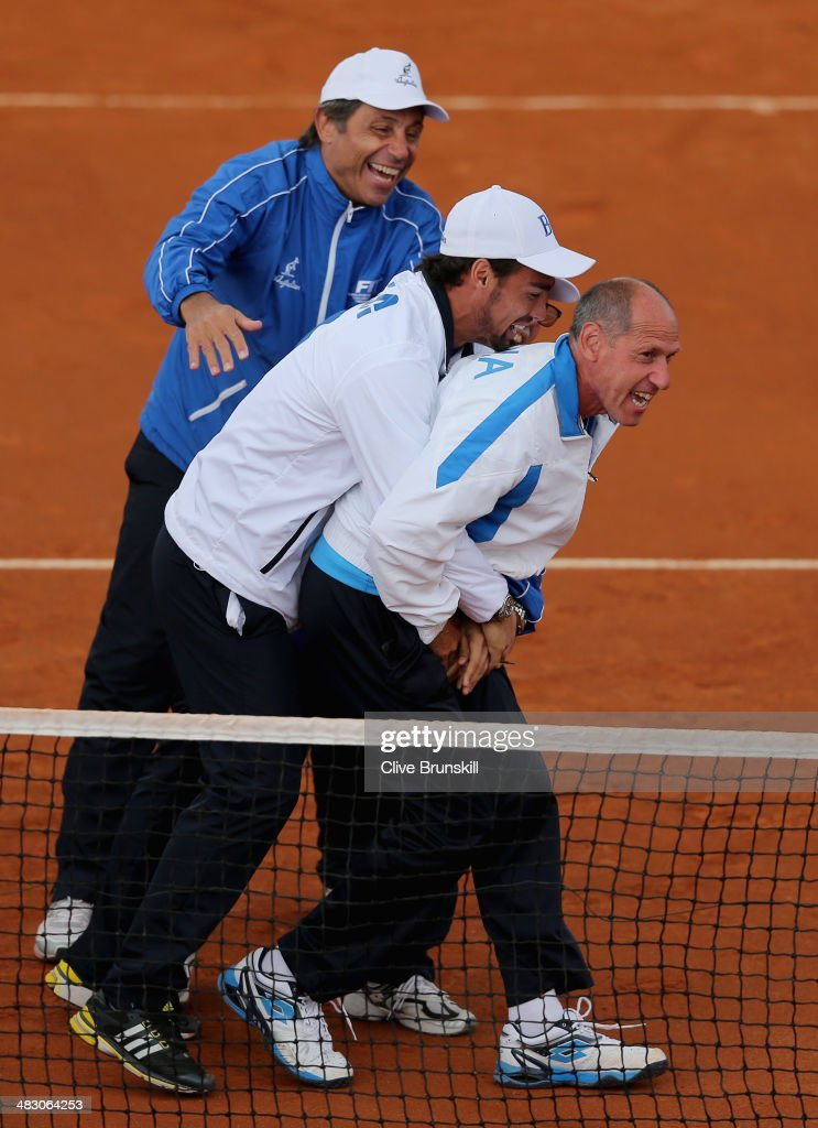 Italian team captain Corrado Barazzutti is grabbed by <a gi-track='captionPersonalityLinkClicked' href=/galleries/search?phrase=Fabio+Fognini&family=editorial&specificpeople=656601 ng-click='$event.stopPropagation()'>Fabio Fognini</a> after Andreas Seppi of Italy has won the fifth and decisive rubber against James Ward of Great Britain during day three of the Davis Cup World Group Quarter Final match between Italy and Great Britain at Tennis Club Napoli on April 6, 2014 in Naples, Italy.