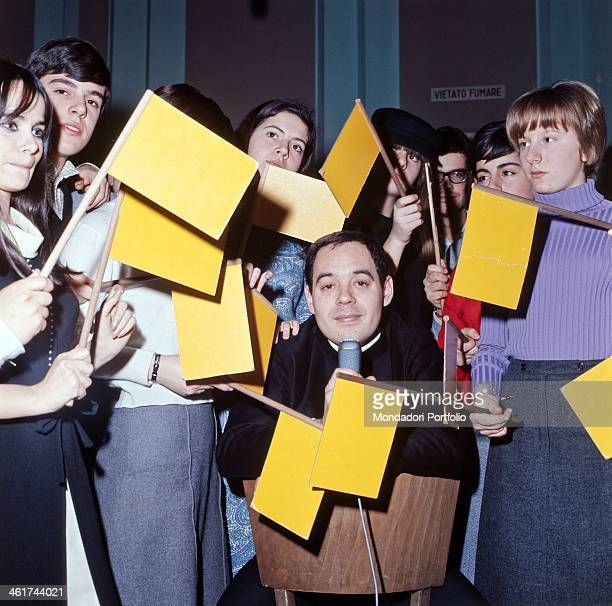Italian television author and director Gianni Boncompagni presenter of broadcast Yellow Flag poses among the young audience that voted their...