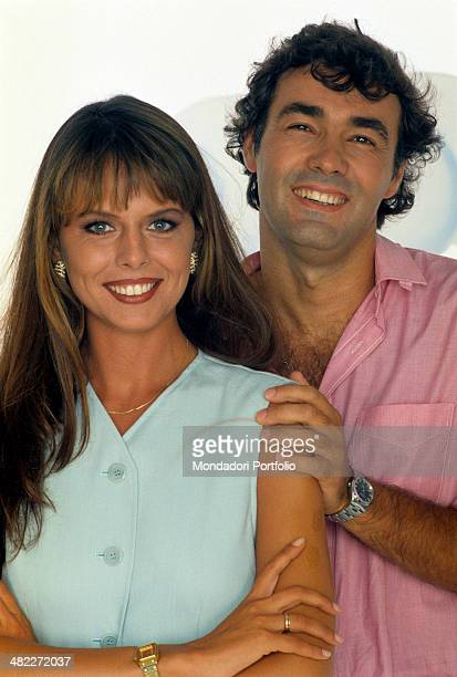Italian television presenter Paola Perego and Italian presenter and journalist Massimo Giletti looking smiling at the camera They both are engaged in...