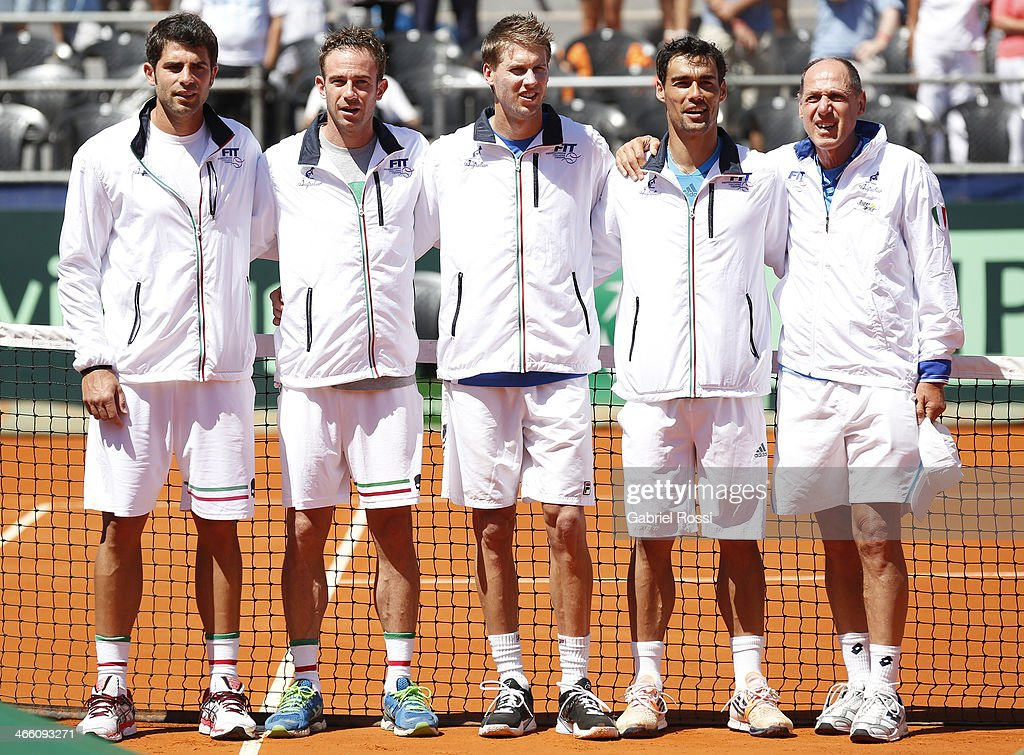 Italian tennis players Simone Bolelli, Filippo Volandri, Andreas Seppi, Fabio Fognini and their coach Corrado Barazzutti pose before a match between Argentina and Italy as part of the Davis Cup at Patinodromo Stadium on January 31, 2014 in Mar del Plata, Argentina.
