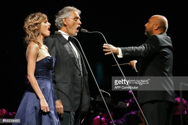 Italian tenor Andrea Bocelli accompanied by Italian soprano Elisa Balbo perform during a concert at the archaeological site of Jerash some 50...