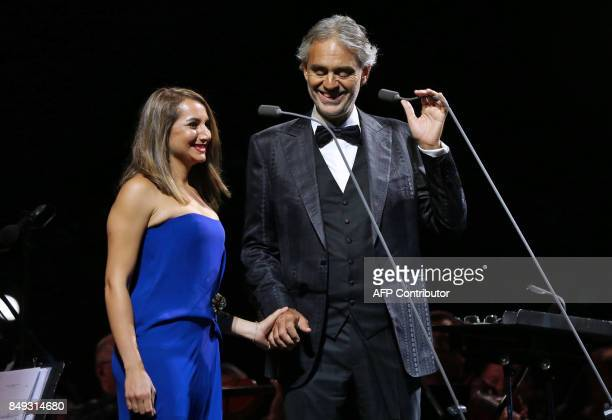 Italian tenor Andrea Bocelli accompanied by Jordanian soprano Dima AlBawab perform during a concert at the archaeological site of Jerash some 50...