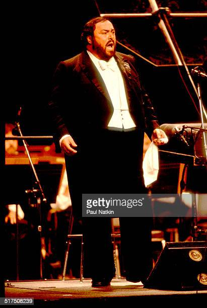 Italian tenor Luciano Pavarotti performs onstage at the Poplar Creek Music Theater Hoffman Estates Illinois August 13 1984