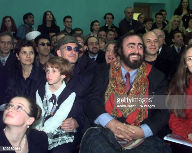Italian tenor Luciano Pavarotti seated beside Bono of U2 watches children perform during a concert of music in Mostar south Bosnia today during the...