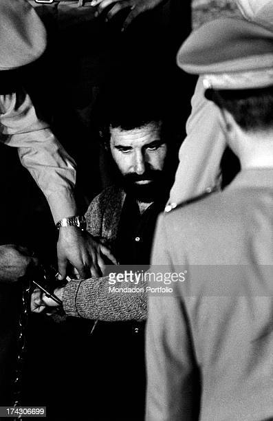 Italian terrorist Renato Curcio founder and ideologist of the leftwing terrorist group Red Brigades sitting handcuffed during the trial at the Corte...