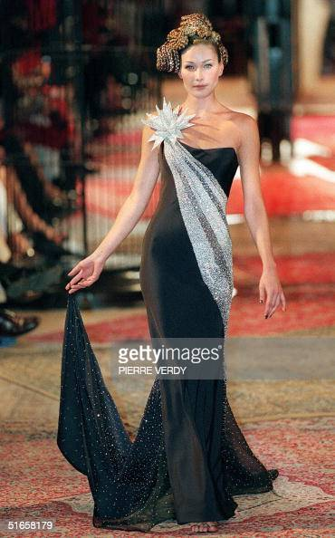 Italian top model Carla Bruni harkens back to the Audrey Hepburn era in this long black and silver evening dress presented by British designer...