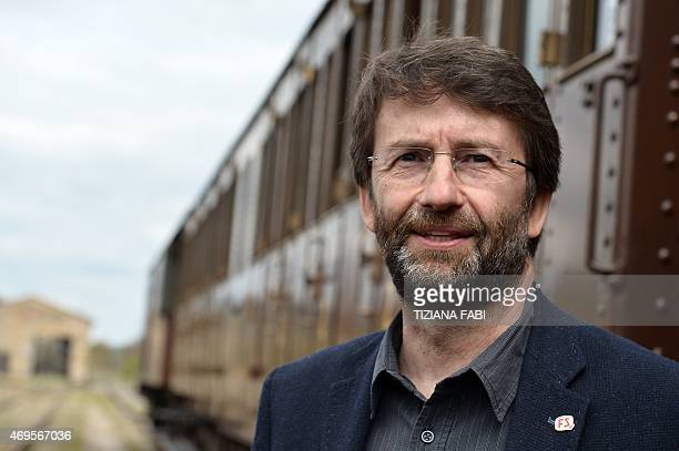 Italian Tourism and Culture Minister Dario Franceschini poses next to the Tuscany's Nature Train on April 11 2015 at the Torrenieri Montalcino...