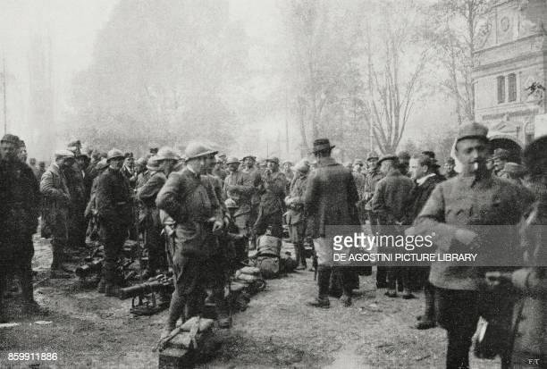 Italian troops guarding at Bolzano station Trentino AltoAdige Italy World War I from L'Illustrazione Italiana Year XLV No 47 November 24 1918