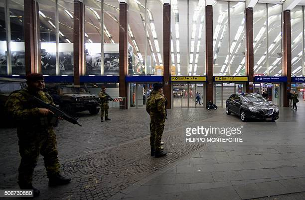Italian troops stand guard outside Rome's Termini station that was evacuated after railway police said they had received an alert that an armed man...