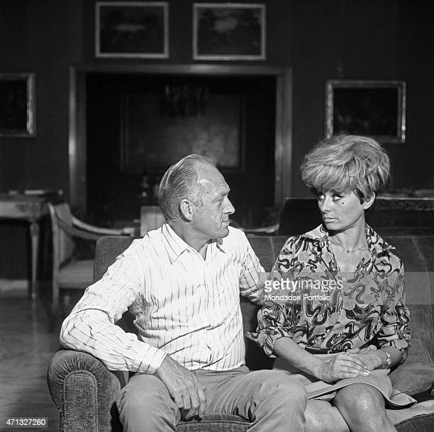 Italian TV artists Raimondo Vianello and Sandra Mondaini sitting on a sofa looking into each other eyes 1967