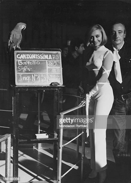 Italian TV host actress singer and showgirl Raffaella Carrà getting ready for dancing the theme song of the Tv music show Canzonissima Beside her...