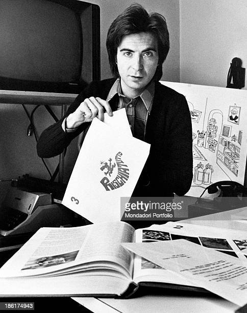 Italian TV host and producer Paolo Limiti showing the logo of the music quiz Rischiatutto designed by himself Milan 1970s
