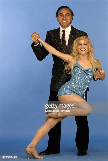 Italian Tv host Pippo Baudo and American dancer singer and showgirl Heather Parisi posing in the studio of the Tv show Serata d'onore Italy 1986