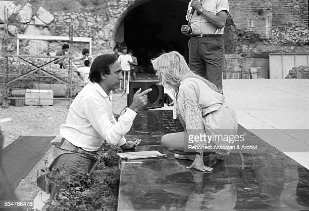 Italian TV host Pippo Baudo and American showgirl Heather Parisi rehearsing the Nastri d'Argento awarding ceremony at the Ancient theatre of Taormina...