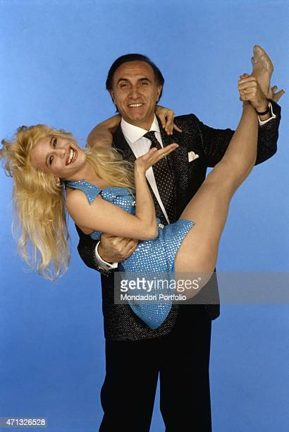 Italian Tv host Pippo Baudo holding American dancer singer and showgirl Heather Parisi in the studio of the Tv show Serata d'onore Italy 1986