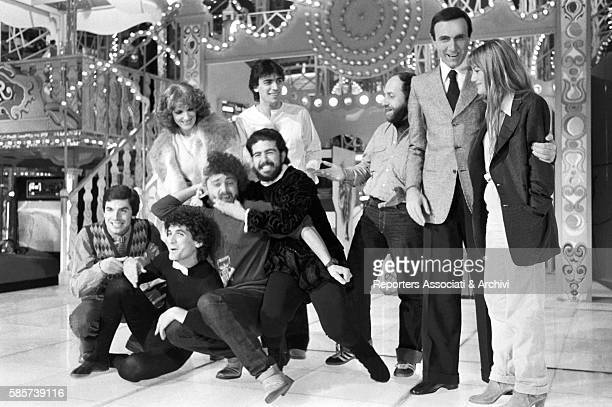 Italian TV host Pippo Baudo posing with the cast of the TV show Luna Park In the picture from the left Tullio Solenghi Massimo Troisi Beppe Grillo...