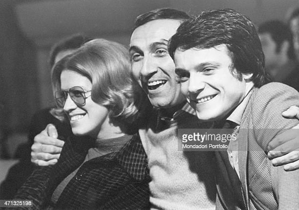 Italian Tv host Pippo Baudo smiling and hugging Italian singers Donatella Moretti and Massimo Ranieri at the music TV show Canzonissima 1972 Rome 1972