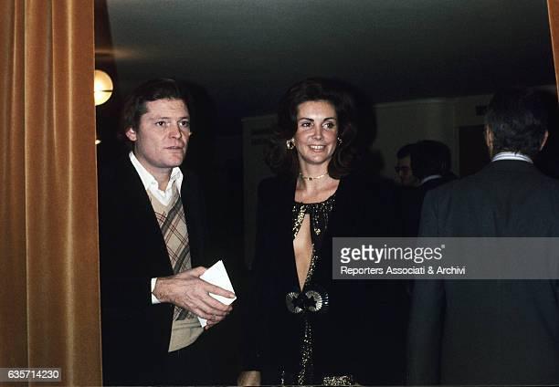 Italian TV personality and stylist Marina Ripa di Meana and Italian painter Franco Angeli attending a soiree Italy 1970s