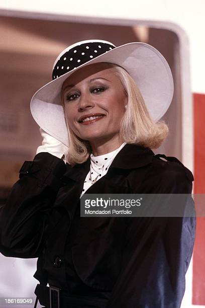 Italian TV presenter actress singer and showgirl Raffaella Carrà wearing a widebrimmed hat in the commercial of Italian kitchen furniture company...