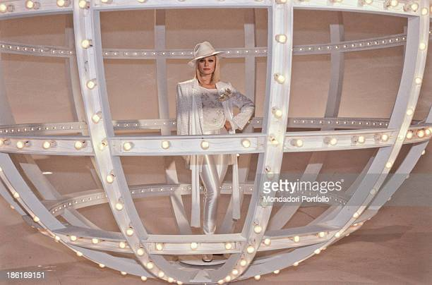Italian TV presenter actress singer and showgirl Raffaella Carrà dancing inside a lighted ball in the TV music show Millemilioni Italy 1981