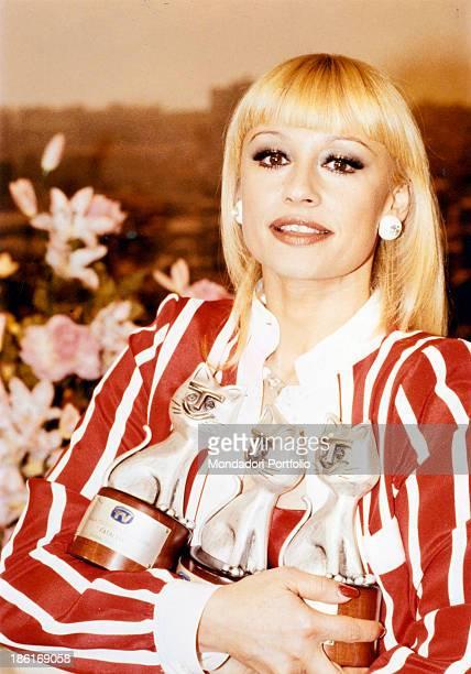 Italian TV presenter actress singer and showgirl Raffaella Carrà holding three Telegatto Italy 1980s