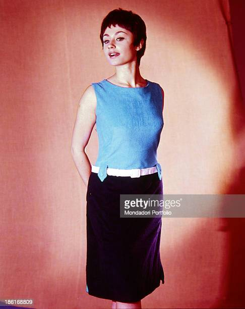 Italian TV presenter actress singer and showgirl Raffella Carrà wearing a black and blue dress with a belt on her waist 1960s