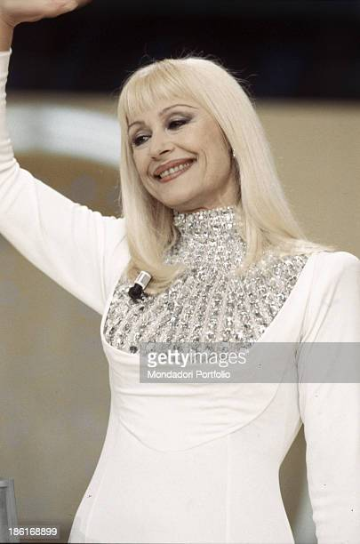 Italian TV presenter actress singer and showgirl Raffella Carrà smiling and greeting in the TV show Carràmba Che fortuna Rome 1998