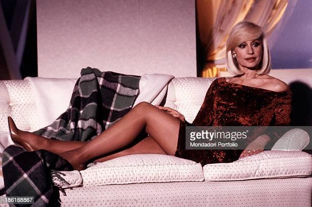 Italian TV presenter actress singer and showgirl Raffella Carrà lying on a sofa 1990