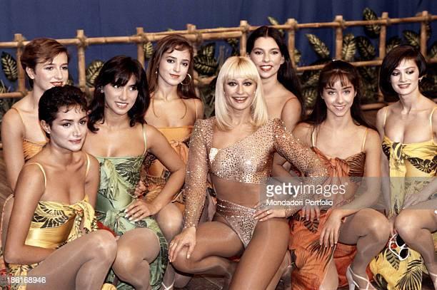 Italian TV presenter actress singer and showgirl Raffella Carrà posing with the dancers of the TV show Pronto Raffaella Rome 1985