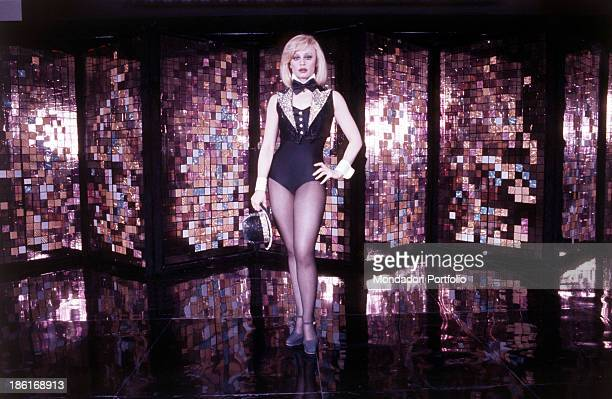 Italian TV presenter actress singer and showgirl Raffella Carrà dancing The woman wears a black leotard trimmed with a bowtie and a sequin waistcoat...